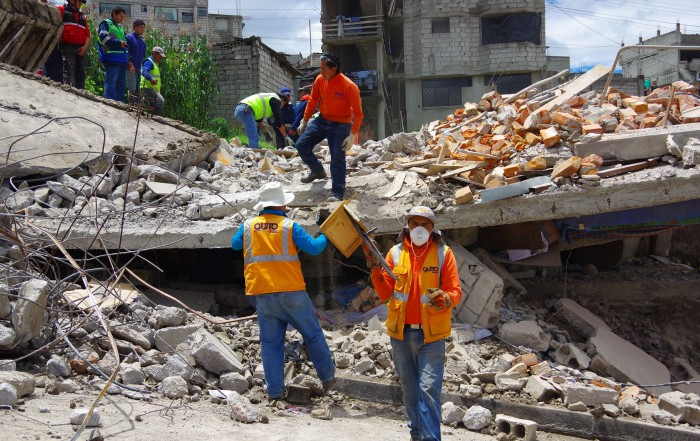 55274917 - quito, ecuador - april,17, 2016: house destroyed by earthquake with rescue team and heavy machinery in the south part of the city.
