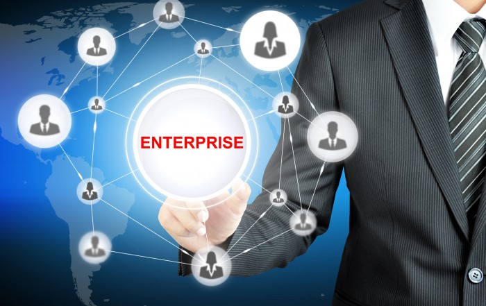 40273459 - businessman pointing to enterprise sign with businesspeople icon network on virtual screen