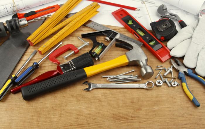 43999389 - assorted work tools on wood