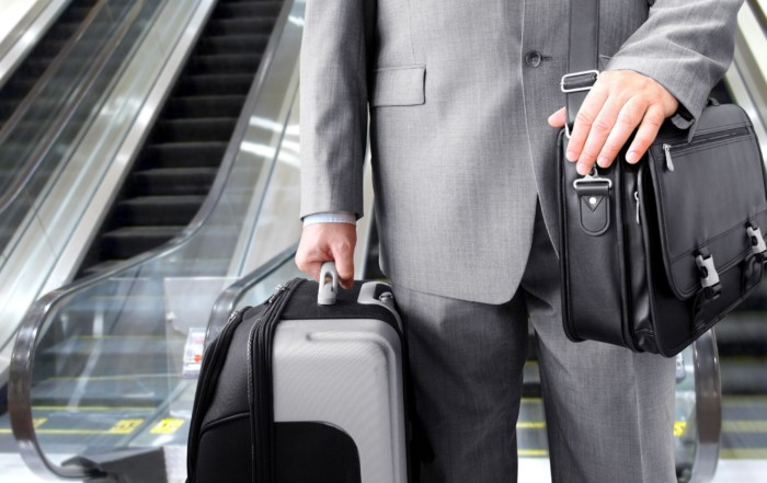 14413938 - businessman with his luggage near an escalator at an airport
