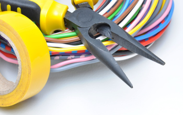 45054486 - electrical tools and cables on metal surface