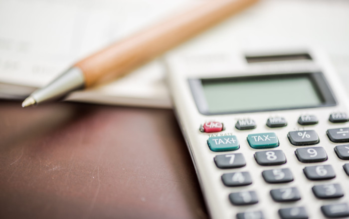 57335413 - taxation and accounting concept with pen and calculator