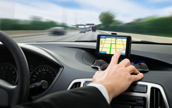 44306049 - close-up of a person's hand using gps navigation system in car