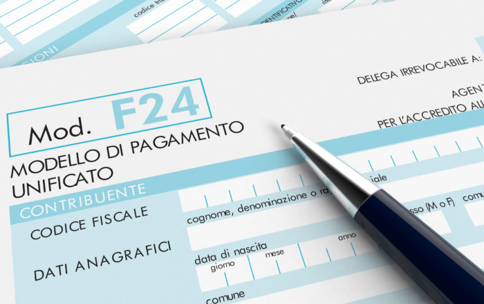 38591524 - close up view of f24 form for italian taxes, with a pen (3d render)